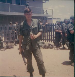 Vietnam soldier holding coca-cola at Camp Radcliff