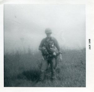 Soldier standing in field