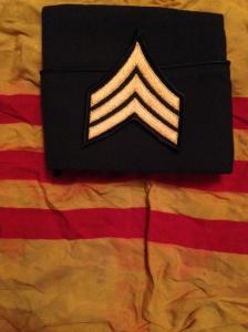 U.S. Army Sergeant stripes atop Republic of Vietnam flag